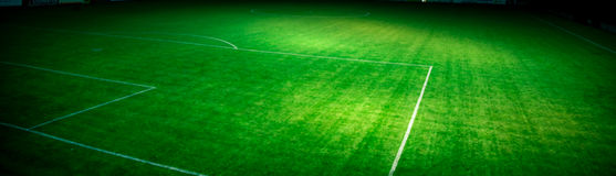 Football pitch at night stock images