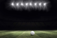 Football pitch at night with ball and lights Royalty Free Stock Photo