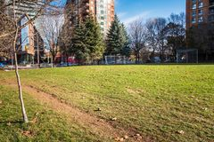 Football Pitch in a Public Park and Blue Sky. Empty Football Pitch in a Public Park on a Sunny Fall Day. Some Apartment Blocks are Visible in Background. Toronto stock photo