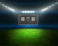 Football pitch with scoreboard and lights Royalty Free Stock Photos