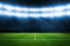 Football pitch under blue lights Stock Photos