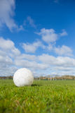 Football on pitch under blue sky Royalty Free Stock Images