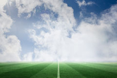 Football pitch under blue sky Stock Photography