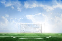 Football pitch under blue sky Royalty Free Stock Photo