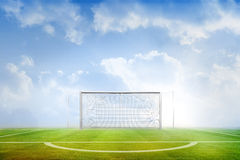 Football pitch under blue sky Royalty Free Stock Image