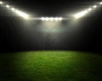 Football pitch under bright spotlights Royalty Free Stock Photos
