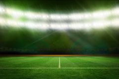 Football pitch under green lights Stock Photography