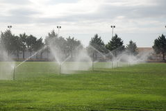 Football Pitch Under Irrigation royalty free stock image