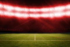 Football pitch under red lights Stock Photo