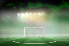Football pitch under spotlights Stock Images