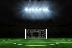 Football pitch under spotlights Stock Image