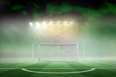 Football pitch under spotlights Royalty Free Stock Images