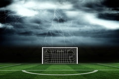 Football pitch under stormy sky Royalty Free Stock Image