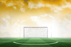 Football pitch under yellow sky Royalty Free Stock Photography