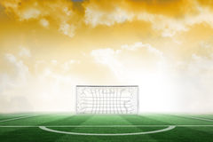 Football pitch under yellow sky Royalty Free Stock Photos