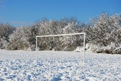 Football pitch in winter snow Stock Image