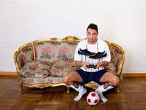 Football plater or nerd Stock Image