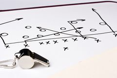 Football play. A silver whistle next to a drawing of a football play Stock Photo