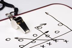 Football play. A silver whistle next to a drawing of a football play Royalty Free Stock Images