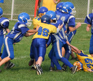 Football Play 4 (youth). Getting ready to tackle in youth football play Stock Photo