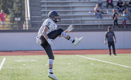 Football Play Signals. A high school football player motions to his teammates royalty free stock images