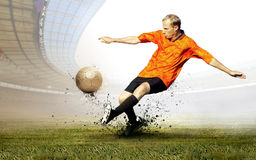 Football player. Shoot of football player on the field of stadium stock images