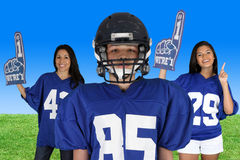 Football Player. With fans cheering for him Royalty Free Stock Photography