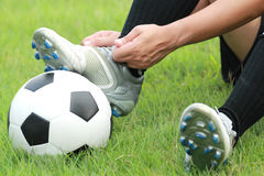 Football player. Man foot on the ball Stock Photo