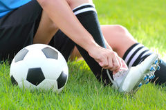 Football player. Soccer boots being tied Stock Photos