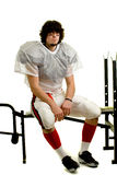 Football Player. American football player. Sitting on weight bench royalty free stock photos
