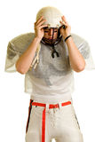Football Player. American football player. Putting on helmet royalty free stock image