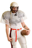 Football Player. American football player. Standing with helmet and ball royalty free stock photos