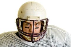 Football Player. American football player. Headshot through facemask royalty free stock image