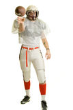 Football Player. American football player. Passing the ball royalty free stock images