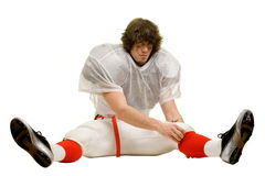 Football Player. American football player. Adjusting uniform while stretching royalty free stock photos