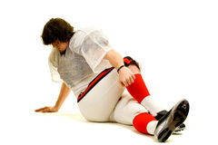 Football Player. American football player. Stretching before game stock photo