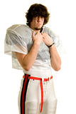 Football Player. American football player. Standing holding shoulder pads stock photo