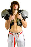 Football Player. American football player. Shirtless holding shoulder pads stock image