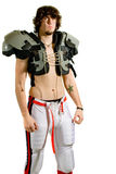 Football Player. American football player. Standing shirtless with shoulder pads stock photography