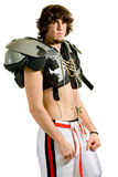 Football Player. American football player. Standing shirtless with shoulder pads stock photos