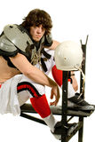 Football Player. American football player. Seated on weight bench royalty free stock images