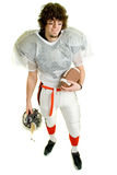 Football Player. American football player. Standing with helmet and ball royalty free stock photo