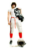 Football Player. American football player. Low-angle, standing with pads and helmet royalty free stock photography