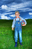 Boy holding colorful football Royalty Free Stock Images