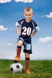 Football player. 5 years old boy posing with football ball in the field Stock Photo