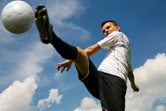 Football player. A football player on the field Royalty Free Stock Photography