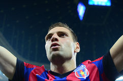 Football player Adrian Popa salutes fans after Champions League game. Steaua's Adrian Popa salutes the fans after the UEFA Champions League game between Steaua royalty free stock photography