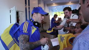 Football player at autograph session after soccer match stock video