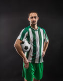 Football-player with a ball Stock Images