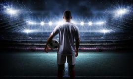 Football player with ball on field of stadium Stock Photos